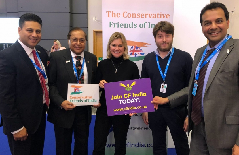 The Rt. Hon. Justine Greening MP, Dr Rami Ranger CBE, Co-Chairman of CF India with CF India team